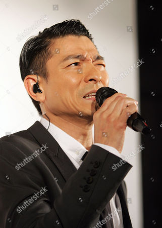 """Hong Kong singer and actor Andy Lau (Lau Tak Wah) sings during a media event announcing his new album """"Unforgettable"""" and celebrating 30 years of performance life, in Taipei, Taiwan. Lau is a Hong Kong Cantopop and Mandarin singer, file actor, and producer. He has been one of Hong Kong's most commercially successful film actors since mid-1980s, performing in more than 120 films while maintaining a successful singing career at the same time. In the 1990s, he was branded by the media as one of the Four Heavenly Kings of Cantopop with Aaron Kwok, Jacky Cheung and Leon LAi"""