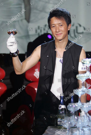 "Han Geng Chinese singer Han Geng poses for photographers during an event to promote his new CD ""Rebirth"", in Taipei, Taiwan"
