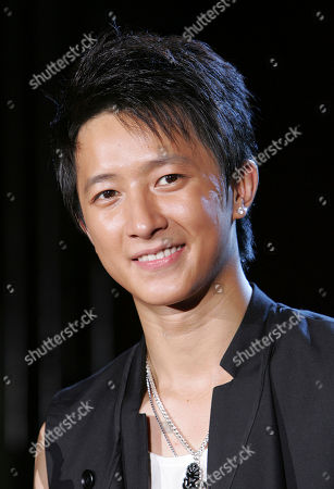 "Han Geng Chinese singer Han Geng smiles for photographers during an event to promote his new CD ""Rebirth"", in Taipei, Taiwan"