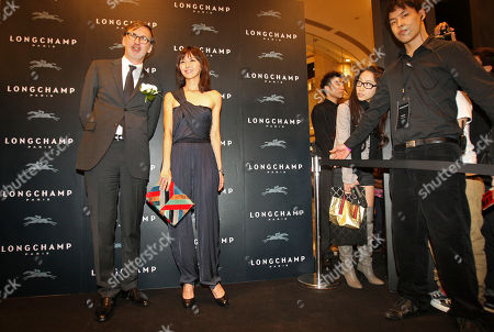 Stefanie Sun, Jean Cassegrain Singapore pop star Stefanie Sun, second right, poses with French luxury goods company Longchamp's CEO Jean Cassegrain during the opening of the Taiwan flagship store in the Taipei 101 building in Taipei, Taiwan