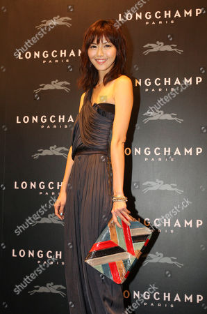Stefanie Sun Singapore pop star Stefanie Sun poses with French luxury goods company Longchamp's hand bag during the opening of the Taiwan flagship store in the Taipei 101 building in Taipei, Taiwan