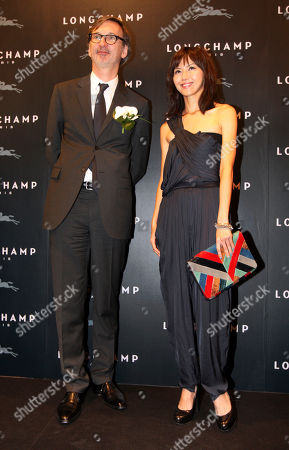 Stefanie Sun Jean Cassegrain Singapore pop star Stefanie Sun, right, poses with French luxury goods company Longchamp's CEO Jean Cassegrain during the opening of the Taiwan flagship store in the Taipei 101 building in Taipei, Taiwan