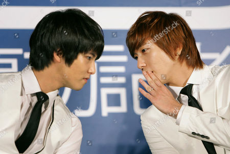 Stock Photo of Jung Yong-hwa, Lee Jong-hyun Members of South Korean pop group CNBLUE Jung Yong-hwa, right, and Lee Jong-hyun whisper to one another during a press conference announcing the group's Taipei tour, in Taiwan. The group is scheduled to meet fans on Sept. 24 - 25 in Taipei