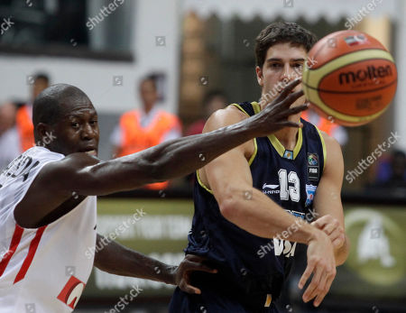 Marcos Mata, Carlos Almeida Marcos Mata, right, from Argentina passes a ball past Carlos Almeida, left, from Angola during their World Basketball Championship preliminary round match in Kayseri, Turkey