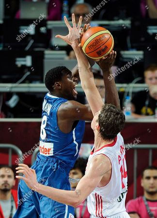 Stock Photo of Ian Mahinmi, Omer Asik France's Ian Mahinmi, left, puts up a shot as Turkey's Omer Asik defends during the eighth final round of the World Basketball Championship, in Istanbul, Turkey