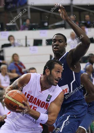 Fadi El Khatib, Ian Mahinmi Lebanon's Fadi El Khatib, front, drives to the basket as he is guarded by France's Ian Mahinmi during their World Basketball Championship preliminary round match in Izmir, Turkey