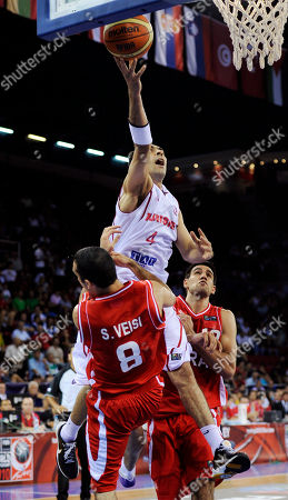 Radhouane Slimane, Saman Veisi Tunisia's Radhouane Slimane, above, puts up a shot as Iran's Saman Veisi defends during the preliminary round of the World Basketball Championship, in Istanbul, Turkey