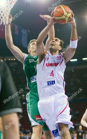 Radhouane Slimane, Slovenia's Gasper Vidmar Tunisia's Radhouane Slimane, right, puts up a shot as Slovenia's Gasper Vidmar defends during the preliminary round of the World Basketball Championship, in Istanbul, Turkey