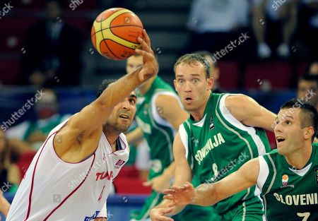 Radhouane Slimane, Samo Udrih, Sani Becirovic Tunisia's Radhouane Slimane, left, goes for the ball along with Slovenia's Samo Udrih, center, and Sani Becirovic during the preliminary round of the World Basketball Championship, in Istanbul, Turkey