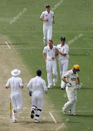 England's Paul Collingwood is congratulated by his teammates after taking the wicket of Western Australian batsman Wes Robinson, caught and bowled for 62 runs, during the 3 day match against Western Australia at the WACA Ground in Perth, Australia