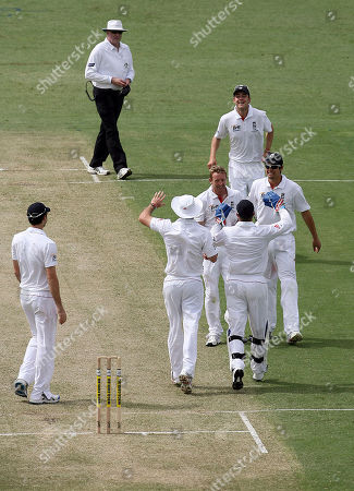 England's Paul Collingwood is congratulated by his team mates, after taking the wicket of Western Australian batsman Wes Robinson, caught and bowled for 62 runs, during the 3 day match against Western Australia at the WACA Ground in Perth, Australia