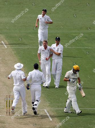 England's Paul Collingwood is congratulated by Alastair Cook after taking the wicket of Western Australian batsman Wes Robinson, caught and bowled for 62 runs, during the 3 day match against Western Australia at the WACA Ground in Perth, Australia