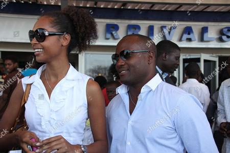 West Indies cricket Legend, Brian Lara, right and his girl friend Susan Gossage upon their arrival in Harare, Thursday, Sept., 2, 2010. The Trindad and Tobago born cricketer is in Zimbabwe as a guest honour at the annual cricket awards