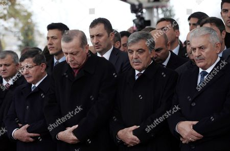 Stock Image of Recep Tayyip Erdogan, Binali Yildirim, Abdullah Gul, Ahmet Davutoglu Turkey's President Recep Tayyip Erdogan, second left, Prime Minister Binali Yildirim, right, former president Abdullah Gul, second right, and former prime minister Ahmet Davutoglu, left, attend funeral prayers for Korkut Ozal, 87, a former Turkish government minister and brother of Turkey's late president Turgut Ozal, at Fatih Mosque in Istanbul