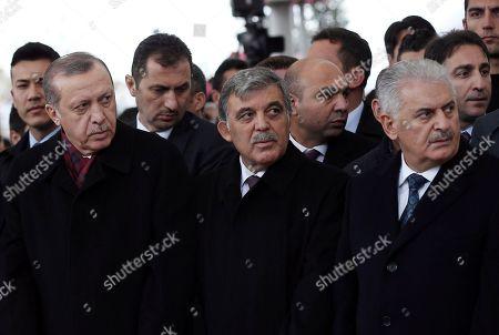Recep Tayyip Erdogan, Binali Yildirim, Abdullah Gul Turkey's President Recep Tayyip Erdogan, left, Prime Minister Binali Yildirim, right, and former president Abdullah Gul attend funeral prayers for Korkut Ozal, 87, a former Turkish government minister and brother of Turkey's late president Turgut Ozal, at Fatih Mosque in Istanbul