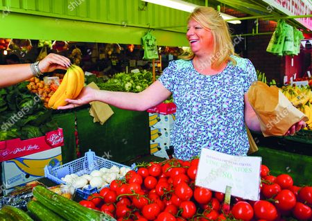 """Stock Image of Banana Girl - Reunion September 2015 Jennifer Hall worked on the fruit and vegetable stall at Peterborough Market on Saturdays for about four years. She said: """"I think I was about 17 when Chris took my photo. I was aware that someone was taking my picture at the time but I wasn't sure who or what it was for""""."""