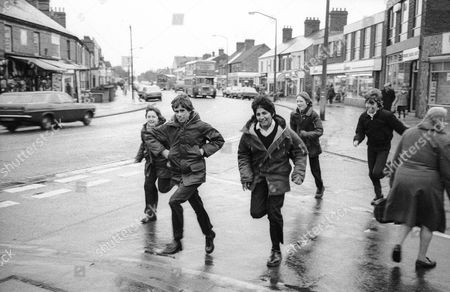Five Boys Running - Original 1980  (left-right )Andy Jackson, Richard Hillson, Devinder Singh, Tony James and Aaron Meadows were around 15 years old in the original picture and running to the chip shop and to play arcade games at the A and B record store in their lunch break. About a year later the all-boys school closed down and their year group was moved to a new school.