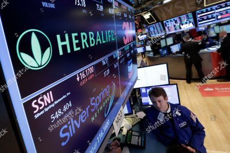 Peter Elkins Specialist Peter Elkins foreground, works at the post thta handles Herbalife, on the floor of the New York Stock Exchange. Billionaire Carl Icahn is extending a years-long proxy fight with co-billionaire Bill Ackman, upping his stake in Herbalife yet again, . The two have been battling over the legitimacy of the supplements and weight loss company since 2012, when Ackman called Herbalife a pyramid scheme and revealed a massive bet against it