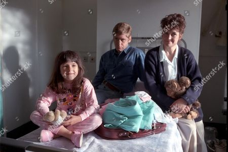 'Fighting for Gemma' - 1993  Checking in - Gemma D'arcy [Jennifer Wilson] with her parents Susan [Lorraine Ashbourne] and Steven [Gary Mavers].