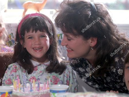 'Fighting for Gemma' - 1993  Gemma [Jennifer Wilson] and her Mum Susan [Lorraine Ashbourne] blow out the candles at Gemma's 4th birthday party.