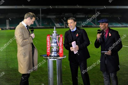 The BBC commentary team of Dan Walker, Phil Neville and Trevor Sinclair with the FA Cup before the The FA Cup match between Eastleigh and Swindon Town at Arena Stadium, Eastleigh