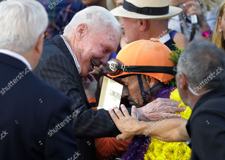 Gary Stevens, Bradley Wayne Hughes Jockey Gary Stevens, center right, is congratulated by owner Bradley Wayne Hughes after riding Beholder to victory in the Breeders' Cup Distaff horse race at Santa Anita, in Arcadia, Calif. Beholder won the race