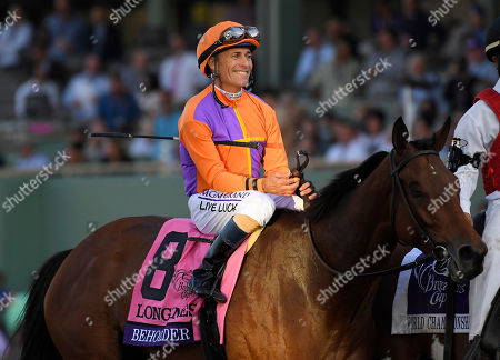 Mike Smith Gary Stevens smiles after Beholder won the Breeders' Cup Distaff horse race at Santa Anita, in Arcadia, Calif