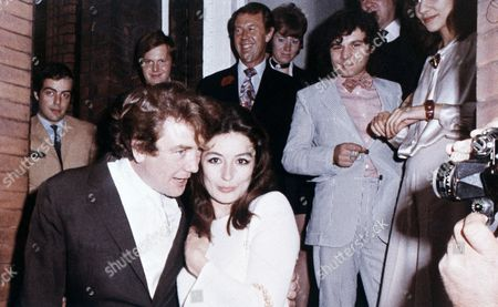 Albert Finney, Anouk Aimee Albert Finney, 34-year-old British actor embraces his bride, French Actress Anouk Aimee, after their registry office wedding in London in 1970