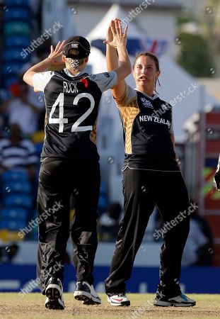 Kate Broadmore, Sian Ruck New Zealand's Kate Broadmore, right, high fives teammate Sian Ruck after she bowled out Australia's Jessica Cameron at the Twenty20 Cricket World Cup women final match in Bridgetown, Barbados