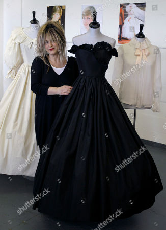 Elizabeth Emanuel British designer Elizabeth Emanuel stands with two dresses and a blouse that she designed for Princess Diana, at an auction house in London. It was black and strapless, with a sassy sequined flounce at the bodice and a gloriously full, swishy skirt. The dress was, Lady Diana Spencer thought, so grown-up, just right for her first official engagement after the announcement she was to marry Prince Charles. The black dress is expected to fetch between 30,000 and 50,000 pounds ($44,000 to $73,000) and the prototype of the wedding dress between 8,000 and 12,000 pounds ($12,000 to $17,000) but understand that Diana's legacy means there's a strong chance a private collector may snap up the garments