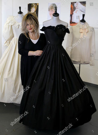 Elizabeth Emanuel Designer Elizabeth Emanuel stands with two dresses and a blouse that she designed for Princess Diana, at an auction house in London. A racy black gown worn by Lady Diana Spencer on one of her first official engagements is up for sale in London. The strapless silk taffeta dress, by designers Elizabeth and David Emanuel, who also designed Diana's frothy wedding gown is expected to fetch between 30,000 pounds and 50,000 pounds ($36,000 to US$61,000) at an auction Tuesday, June 8, 2010