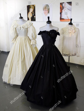 Two dresses and a blouse designed for Princess Diana by designer Elizabeth Emanuel displayed at an auction house in London. It was black and strapless, with a sassy sequined flounce at the bodice and a gloriously full, swishy skirt. The dress was, Lady Diana Spencer thought, so grown-up, just right for her first official engagement after the announcement she was to marry Prince Charles. The black dress is expected to fetch between 30,000 and 50,000 pounds ($44,000 to $73,000) and the prototype of the wedding dress between 8,000 and 12,000 pounds ($12,000 to $17,000) but understand that Diana's legacy means there's a strong chance a private collector may snap up the garments