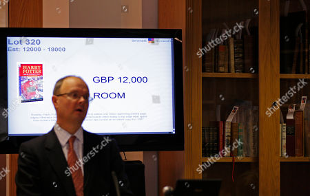 A Bloomsbury auctioneer calls out the sale of the first edition of 'Harry Potter and the Philosopher's Stone' by J K Rowling during the 'Continental & English Antiquarian Books, Modern First Editions' auction in London, . The book sold for a hammer down price of 12,000 pounds (US$17,567 or 13,978 euro