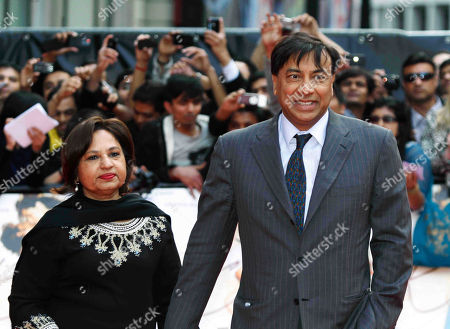 Lakshmi Mittal, Usha Mittal Indian steel magnate and billionaire Lakshmi Mittal, right, accompanied by his wife Usha, left, arrives for the European film premiere of the film 'Kites', in London