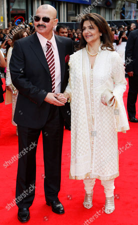 Stock Image of Rakesh Roshan Indian producer Rakesh Roshan, left, accompanied by his wife, name not available, pose for the photographers as they arrive for the European film premiere of his latest film 'Kites', in a central London cinema