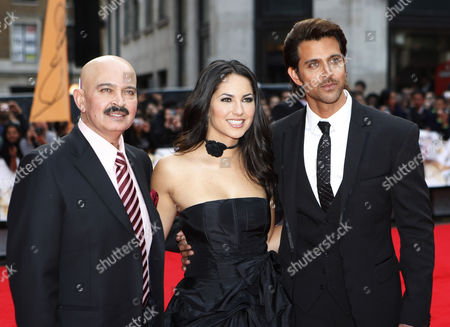 Stock Image of Rakesh Roshan, Barbara Mori, Hrithik Roshan Indian producer Rakesh Roshan, left, with the two stars Mexican actress Barbara Mori, center, and Indian actor Hrithik Roshan, pose for the photographers as they arrive for the European film premiere of their latest film 'Kites', in a central London cinema