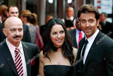 Stock Picture of Rakesh Roshan, Barbara Mori, Hrithik Roshan Indian producer Rakesh Roshan, left, with the two stars Mexican actress Barbara Mori, center, and Indian actor Hrithik Roshan, pose for the photographers as they arrive for the European film premiere of their latest film 'Kites', in London