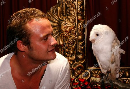 Josh Herdman British actor Josh Herdman poses with an owl after his arrival for the launch of video game 'Lego Harry Potter' at a store in London
