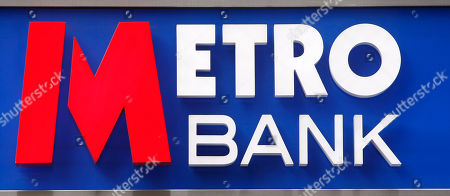 The logo on the outside the first branch of the new British high street bank, the Metro Bank, in London, . Britain's first retail bank in more than 100 years, opened for business accompanied with an array of gimmicks to attract maximum publicity, such as the offer of biscuits for customers' dogs and free breakfasts for clients, and a business plan inspired by the model used by its co-founder, billionaire Vernon Hill, when he founded America's Commerce Bank in 1973