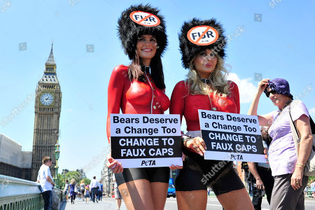 Lucy Clarkson, Victoria Eisermann Supporters of PETA, People for the Ethical Treatment of Animals, former Lara Croft model, Lucy Clarkson, left, and PETA Europe's sexiest Vegetarian and model, Victoria Eisermann wearing painted-on Queen's Guards uniforms and faux-fur caps demonstrate on Westminster Bridge in London against the use of real bearskins in the Queen's Guards ceremonial cap