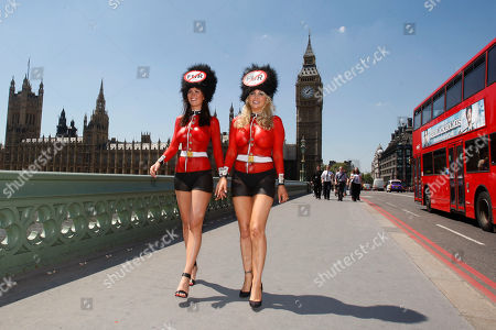 Lucy Clarkson, Victoria Eisermann Supporters of PETA, People for the Ethical Treatment of Animals, former Lara Croft model, Lucy Clarkson, left, and PETA Europe's sexiest Vegetarian and model, Victoria Eisermann wear body painted Queen's Guards uniforms and faux-fur caps demonstrate on Westminster Bridge in London against the use of real bearskins in the Queen's Guards ceremonial cap