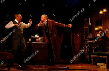 Cast members and British actors Peter Egan, right, as Holmes and Robert Daws as Watson pose for photographers during a photocall for the new production of 'The Secret of Sherlock Holmes' at the Duchess Theatre in London