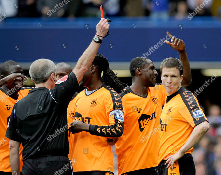 Martin Atkinson, Gary Caldwell Wigan Athletic Gary Caldwell, right, is shown the red card by match referee Martin Atkinson, left, after fouling Chelsea's Frank Lampard in the penalty area during their English Premier League soccer match at the Stamford Bridge Stadium, London, . (AP Photo/Tom Hevezi) ** NO INTERNET/MOBILE USAGE WITHOUT FOOTBALL ASSOCIATION PREMIER LEAGUE(FAPL)LICENCE. CALL +44