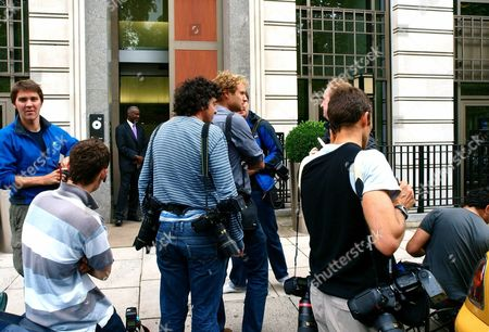 """Media gather outside the BP headquarters in London as security personnel secure the entrance following reports, that the BP chief executive Tony Hayward would be leaving his post. BP said Monday that """"no final decision"""" had been made about management changes, but American Bob Dudley, the man overseeing the company daily response to the Gulf oil spill crisis, is currently being seen as the most likely choice to replace Hayward"""