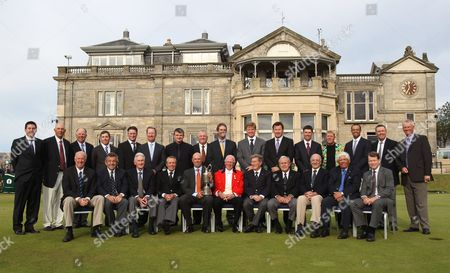 Former British Open Champions pose on the 1st tee on the Old Course at St. Andrews, Scotland, . 28 Champions have accepted the invitation to play four holes of the Old Course on Wednesday 14 July, the day before the Open Championship gets underway. Back row from left, Ben Curtis, Tom Lehman, Mark O'Meara, Justin Leonard, Todd Hamilton, David Duval, Paul Lawrie, Mark Calcavecchia, Ian Baker-Finch, Ernis Els, Nick Faldo, Padraig Harrington, John Daly, Tiger Woods, Bill Rogers, Sandy Lyle. Front row from left, Tom Weiskopf, Tony Jacklin, Bob Charles, Gary Player, Stewart Cink, club captain Colin M. Brown, Peter Thomson, Arnold Palmer, Roberto de Vicenzo, Lee Trevino, Tom Watson