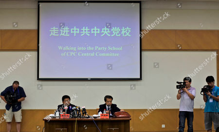 Stock Image of Chen Baosheng, seated left, vice president of the Communist Central Party School, answers a reporter questions in Beijing, China, . China threw open the gates of its secretive Central Party School on Wednesday, offering foreign journalists a rare but carefully scripted peek at the leafy campus where the country's communist elite are trained