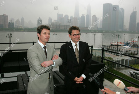 Danish Crown Prince Frederik, left, and Danish Minister of Economic and Business Affairs, Brian Mikkelsen, brief the media during a visit to the Nordic lighthouse in Shanghai, China