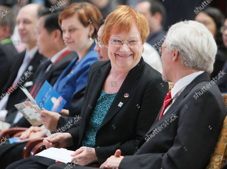 Tarja Halonen Pentti ArajSrvi Finnish President Tarja Halonen, 2nd right, and her husband Pentti Arajarvi, right, chat during the Finland Pavilion Day opening ceremony at the World Expo site in Shanghai, China