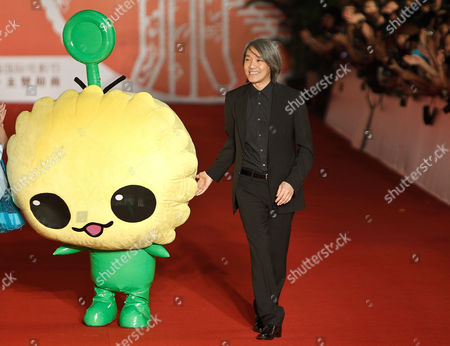 Stephen Chow Hong Kong actor Stephen Chow arrives with a movie mascot at the opening of 13th Shanghai International Film Festival in Shanghai, China