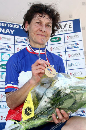 Jeannie Longo Former Olympic champion Jeannie Longo on the podium displaying her gold medal after winning the 24.7 km race against the clock in the French cycling championship in Chantonnay, western France. Longo was cleared of breaching anti-doping rules by the French Cycling Federation, in an embarrassing reversal for the French Anti-Doping Agency. The 53-year-old Longo had faced a ban from three months to two years, a sanction that would effectively have ended the career of one of France's favorite athletes. Now she has a chance to ride at the London Olympics if she qualifies